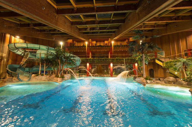 Garni sonnwend vacanza in mezzo ai frutteti a plaus for Piani di piscina coperta